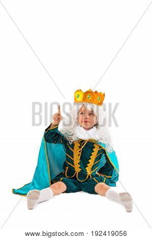 The little prince sits lifting his index finger. White background.