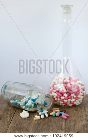 The medical pills are on a money. Colorful pills on white background.