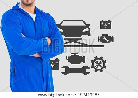 Digital composite of mechanic with arm crossed against car icons