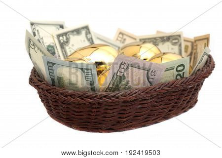 Golden eggs and dollars in basket isolated on white background