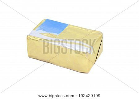 Stick of wrapped butter isolated on white background