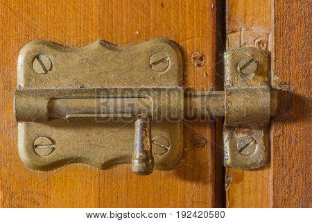 A bolt on an old wooden door
