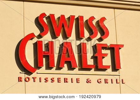 DARTMOUTH CANADA - JUNE 23 2017: Swiss Chalet sign Swiss Chalet is a Canadian owned restaurant chain and is part of Cara Operations which also owns Harvey's.