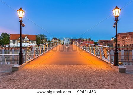 Catwalk over Motlawa river in Gdansk at dusk, Poland