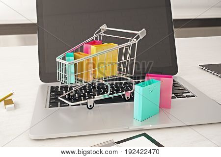 Front view of empty laptop computer screen with cart and colorful bags. Buying online concept. Mock up 3D Rendering