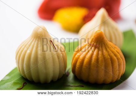 A modak is an Indian sweet dumpling popular in many parts of India. It is called modak in Marathi and Konkani as well as Gujarati language, Kozhakkatta in Malayalam, modhaka or kadubu in Kannada