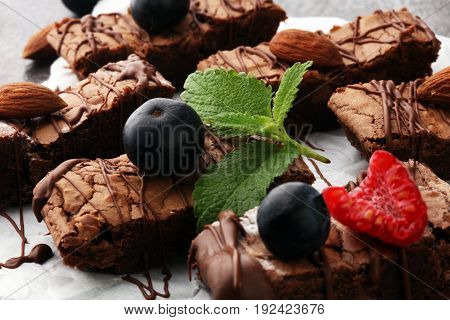 homemade chocolate brownies on grey wooden background