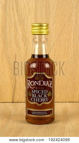 RIVER FALLS,WISCONSIN-JUNE 23,2017: A bottle of Rondiaz brand black cherry rum with a wood background.
