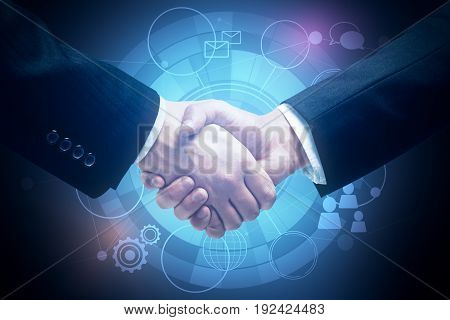 Close up of handshake on blue background with digital business icons. Partnership concept