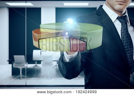 Businessman drawing abstract transparent business diagram in blurry meeting room interior. Profit concept. 3D Rendering