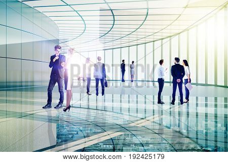 Businessmen and women communicating in transparent glass building. Partnership concept. Double exposure