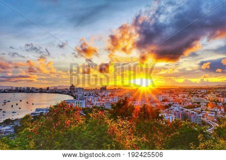 Beautiful sunrise with panorama seaview and city in Pattaya Thailand.