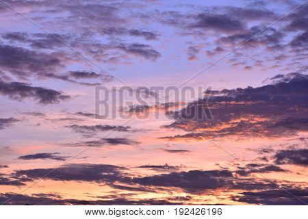 Coloful clouds on blue sky background with sunrise.