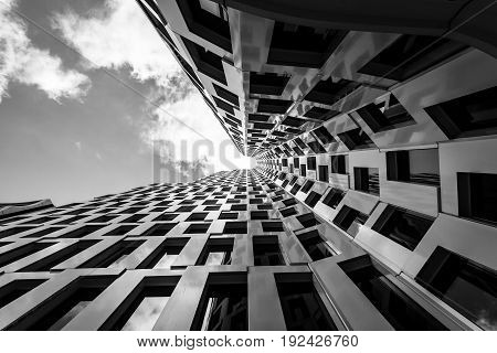 BERLIN - JUNE 17 2017: Upper West (Atlas Tower)- new skyscraper (119 m) at tne Breitscheidplatz in West Berlin. Black and white.