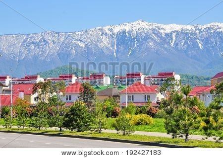 house on a background of mountains in the Adler district of Sochi.