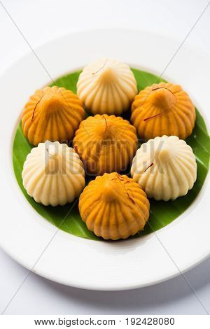 A modak is an Indian sweet dumpling popular in India. It is called modak, Kozhakkatta, modhaka, kadubu, modhakam, kozhakkattai, kudumu. made up of coconut and jaggery, rice flour, wheat with khova