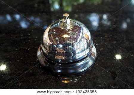 The ringing bell on the black table