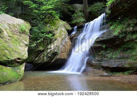 Water in Motion showing milky effects between two large boulders