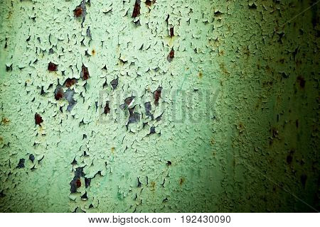 Old rusty metal painted with green paint as background .
