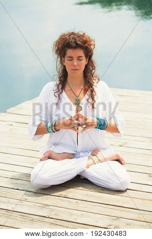 young woman practice yoga outdoor by the lake healthy lifestyle concept full body shot