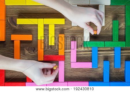 Maze of wooden blocks flat lay. The concept of manipulation peoples. Man in the labyrinth the search for the exit top view. Puppeteer people management business manipulation.