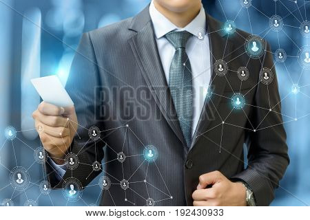 Businessman Is Holding The Payment Card .