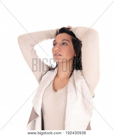 A beautiful young Hispanic woman in a deerskin jacket standing with her hands on her head isolated for white background.