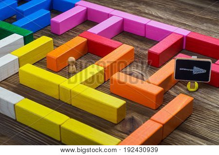 Man in the labyrinth the search for the exit. Labyrinth of colorful wooden blocks tetris. The man in the maze. The concept of a business strategy analytics search for solutions the search output.