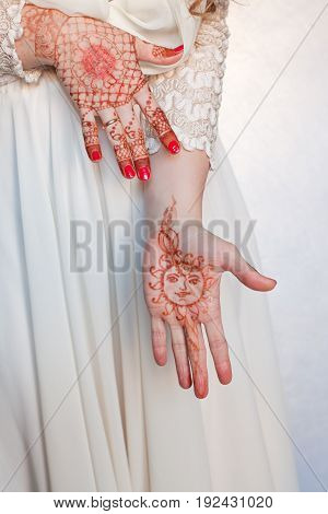 Women's hands, drawings of henna, Vedic symbols and patterns