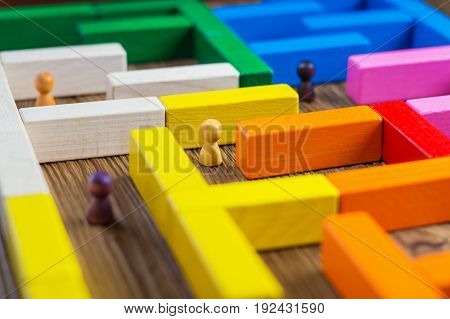 People in the maze finding a way out. The man in the maze. The concept of a business strategy analytics search for solutions the search output. Labyrinth of colorful wooden blocks.