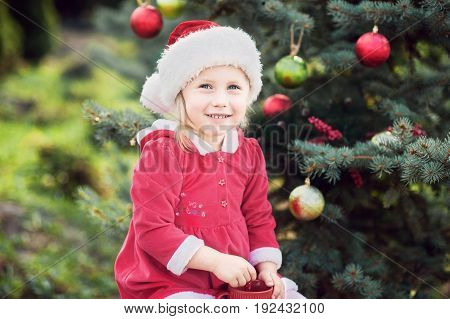 Little Girl Waiting For A Christmas In The Wood. Christmas In Juli.