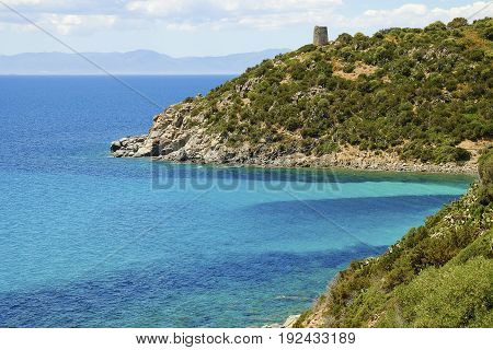 View on the Spanish Tower and the beach Mare Pintau in Sardinia Italy.