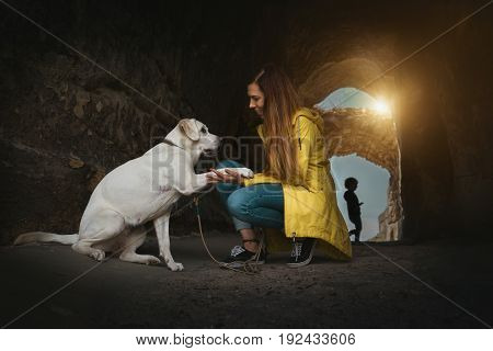 Labrador dog puppy and young woman give a High Five - cinematic scene