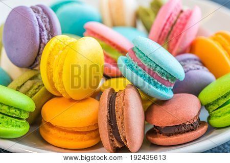 Colourful and sweet Macaroon or macaron on white background. macaron is a sweet confection made with egg white, icing sugar, granulated sugar, almond powder or ground almond, and food coloring.
