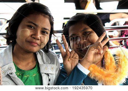 U-BEIN BRIDGE/AMARAPURA, MYANMAR JAN 22: Portrait of burmese girls on a school trip to U-Bein Bridge are posing for a photo January 22, 2016, U-Bein bridge/Amarapura.