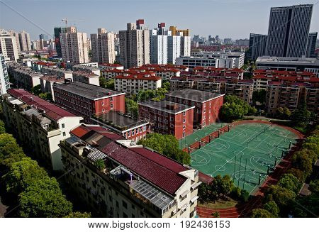 Urban residential compound in Shanghai during afternoon - Same picture available for noon, afternoon, evening and night