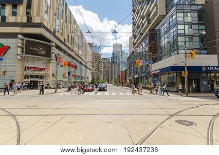 Toronto Canada - 2 July 2016: Dundas Street and Bay Street corner in Toronto with people walking in the crosswalk