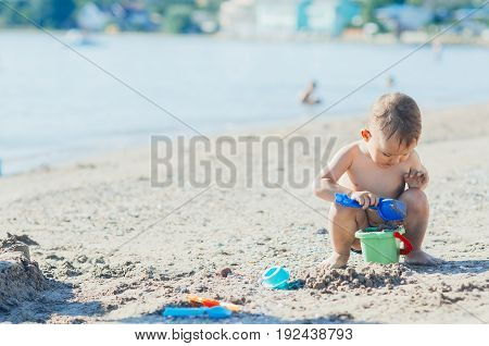 Little Boy On The Beach Near The Sea Plays