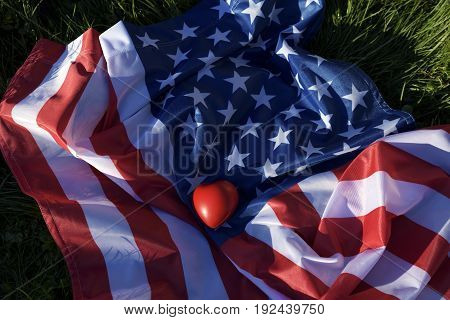 American flag and red heart in the park
