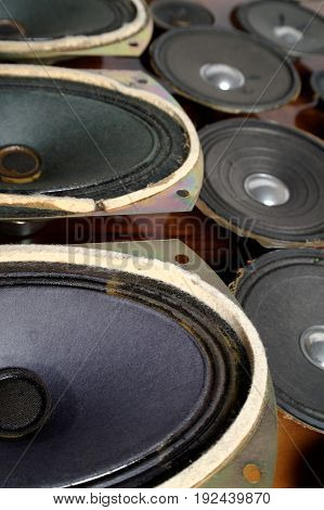 old dusty speakers collection in perspective view