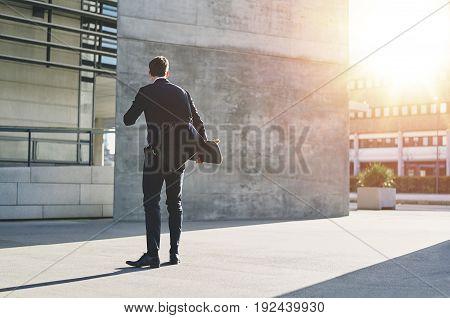 Stylish Man Wearing Jacket Standing With Skateboard