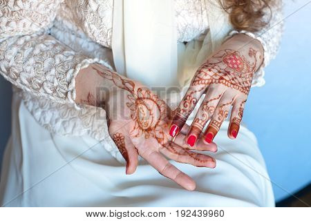 Vedic symbols and patterns. Women's hands, drawings of henna,