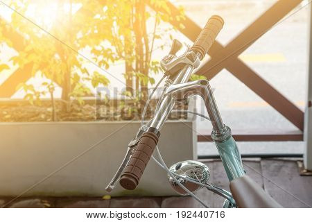Handlebar of a bicycle on natural bokeh background. Travel and exercise concept
