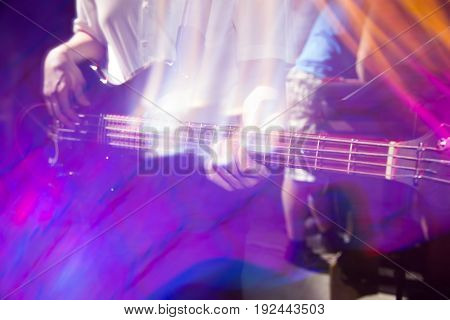 Musician playing guitar in a rock band