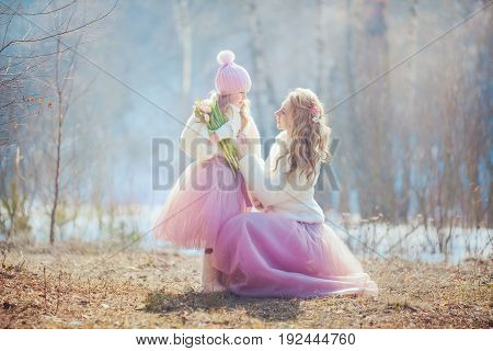 Beautiful mother with daughter in spring park