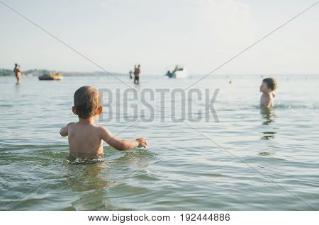 Little Boy Swimming In Sea