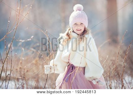 Beautiful little girl in early  spring park