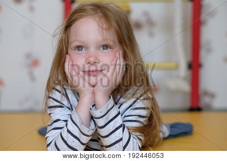 Portrait of caucasian small girl dreaming during game