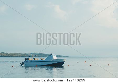 Empty Motor Boat Stands Near The Buoys,