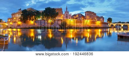 Panoramic view of Tiber riverside with Church of the Sacred Heart of Jesus in Prati and mirror reflection during evening blue hour in Rome, Italy